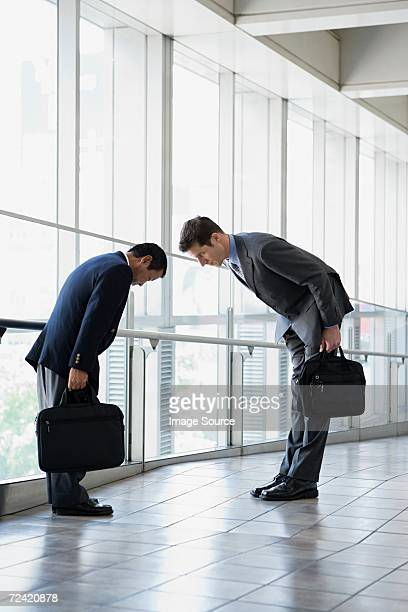 Businessmen greeting