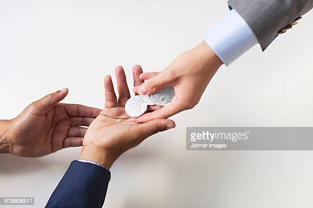 Businessmen hands with coins