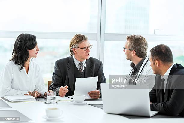 Businessmen having a meeting with doctors.