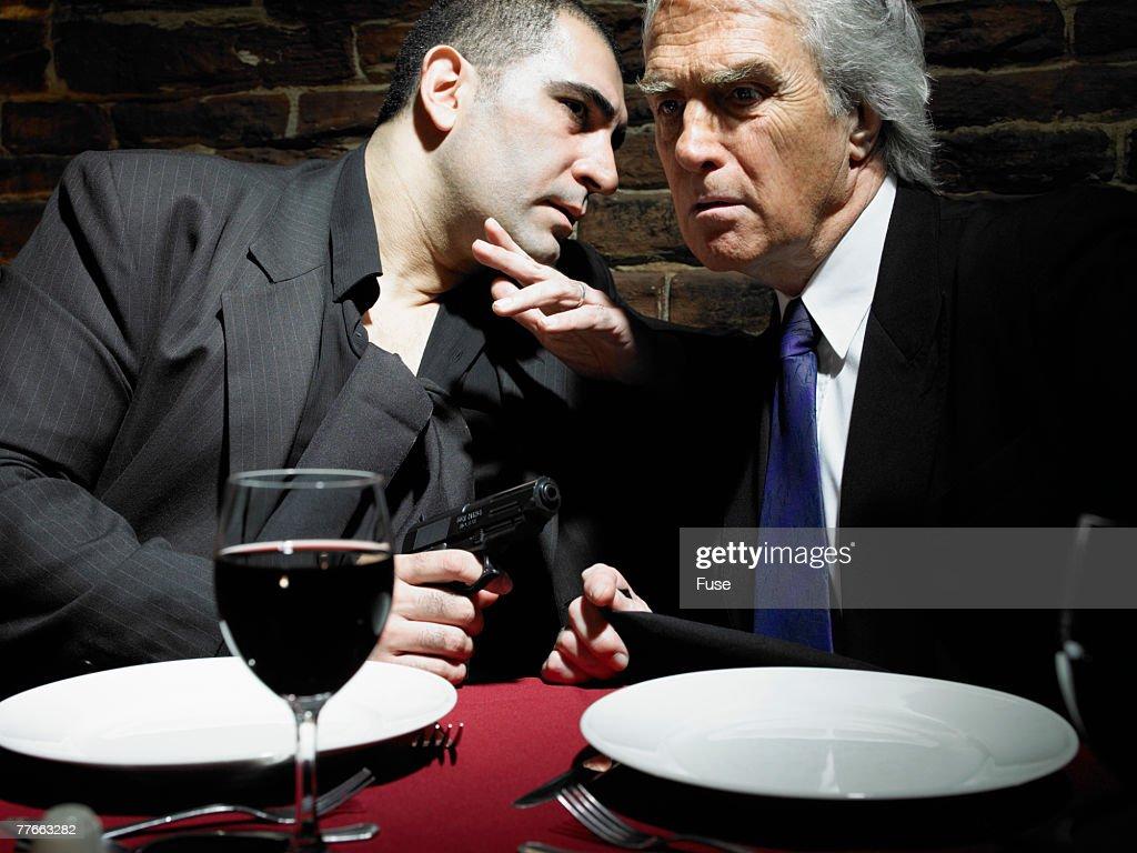 Businessmen Having a Private Conversation