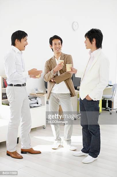 Businessmen having coffee break