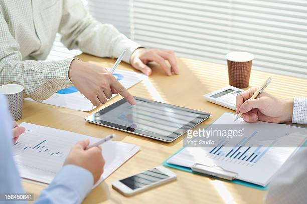 Businessmen  having discussion in office