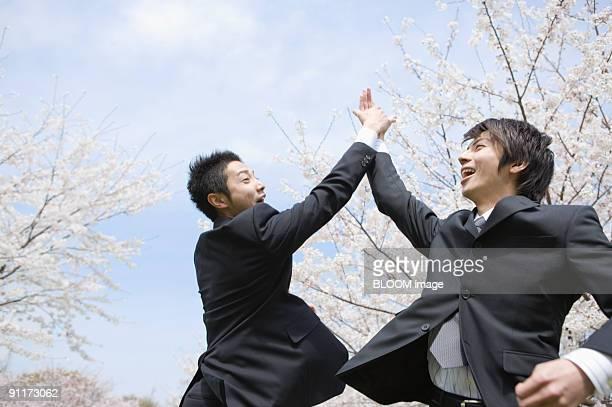 Businessmen having high-five