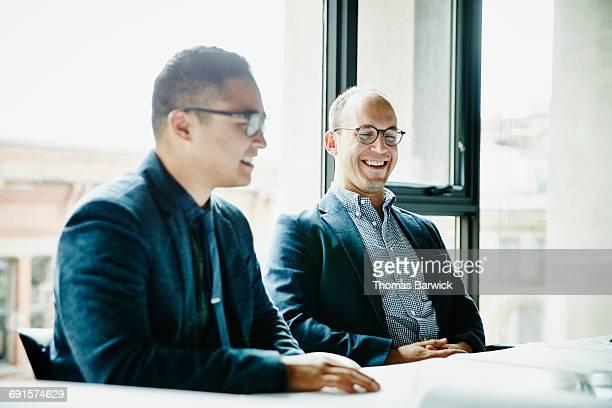 Businessmen having informal project discussion