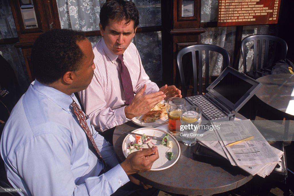 Businessmen having lunch : Stock Photo