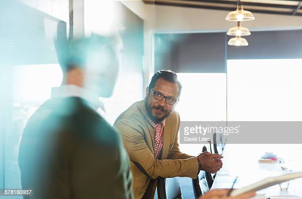 Businessmen having meeting in conference room