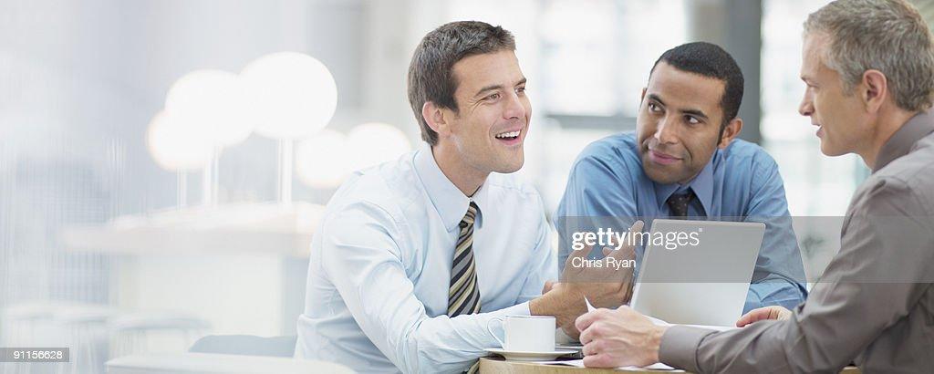 Businessmen having meeting in office : Stock Photo