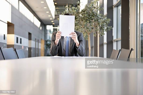 Businessmen holding paper work in front