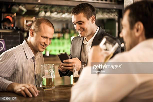 Businessmen in a bar after work.