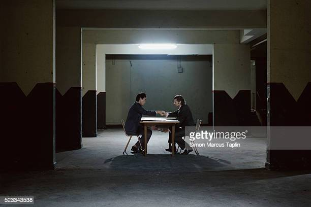 Businessmen in a Dark Room