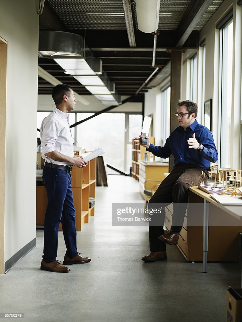 Businessmen in discussion in office : Stock Photo