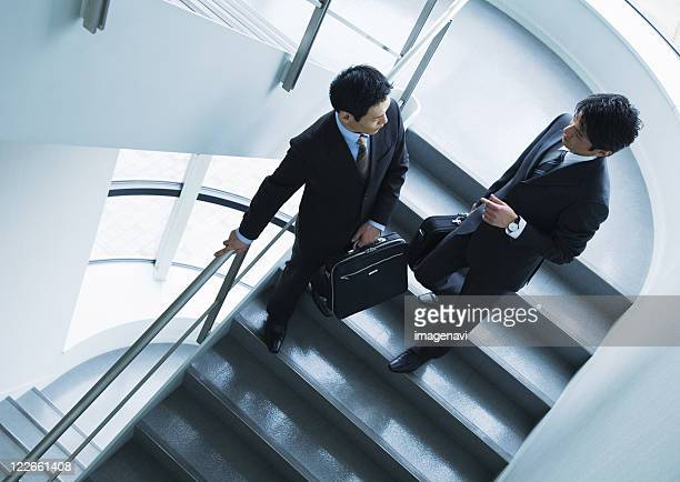 Businessmen in discussion on stairs