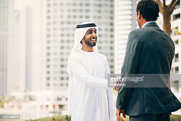 Businessmen in Dubai handshake
