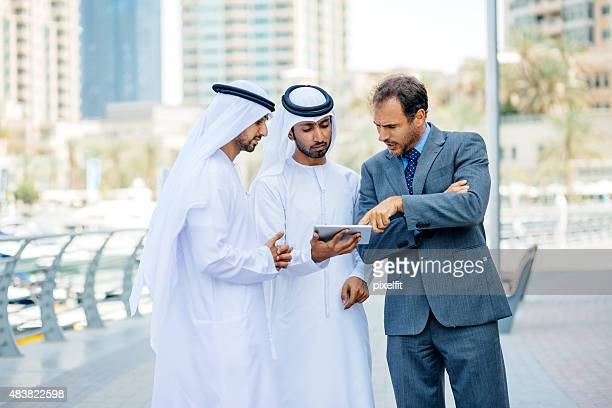 Businessmen in Dubai making business