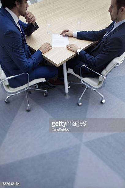 Businessmen in negotiation at meeting table
