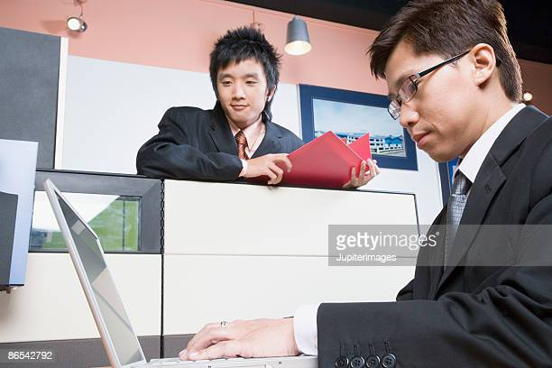 Businessmen in office cubicles