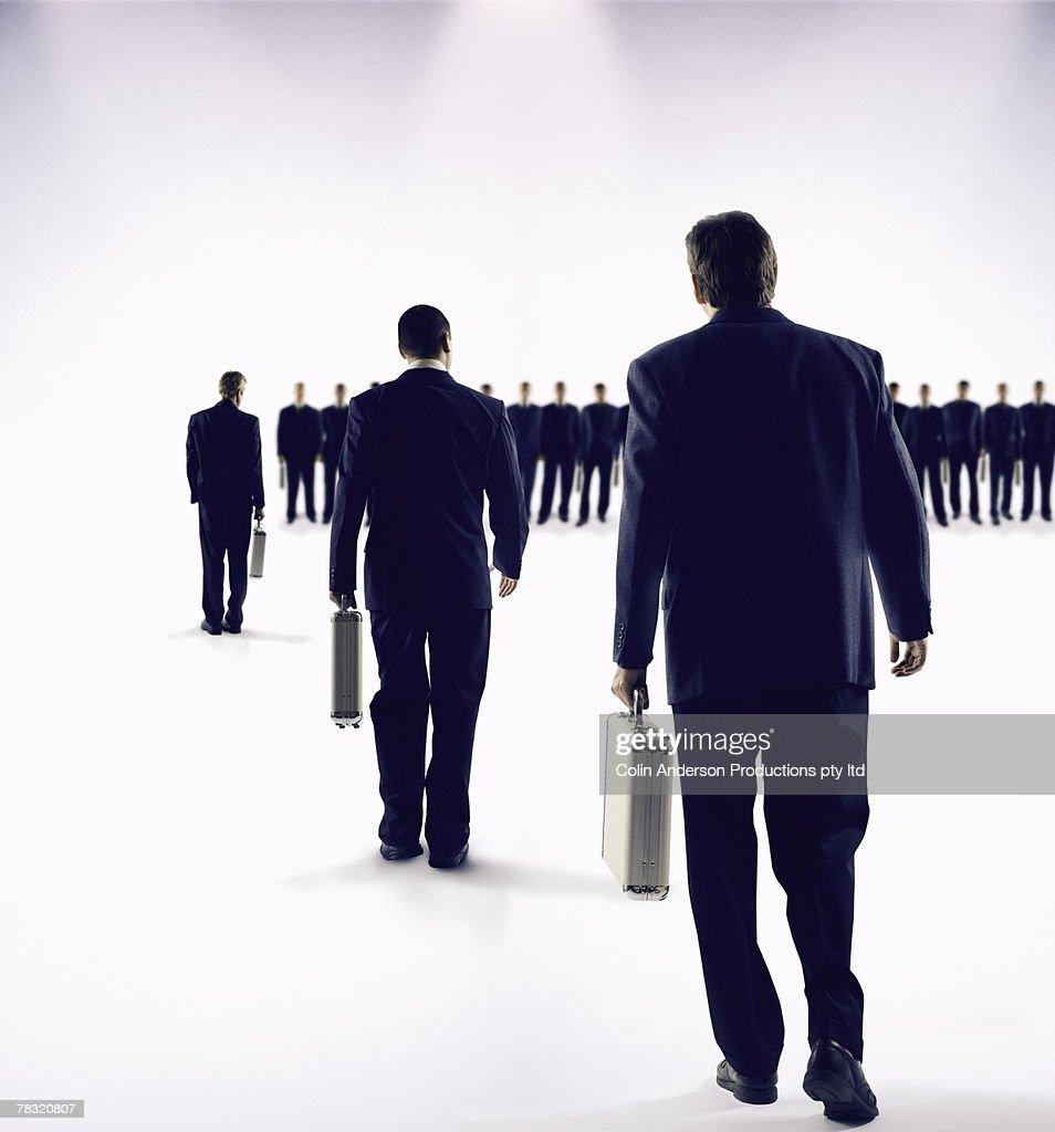 Businessmen in single file line : Stock Photo