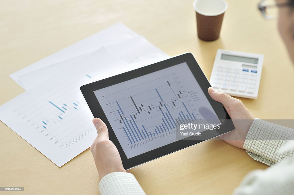 Businessmen in the office,using digital tablet