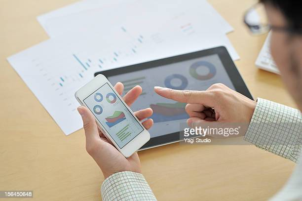 Businessmen in the office,using smartphone