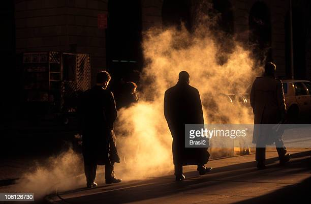 Businessmen in Trench Coats Walking to Work on Early Morning