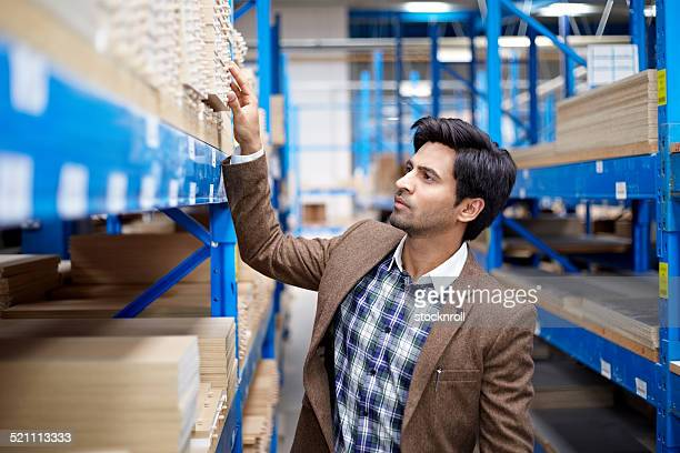 Businessmen in warehouse preparing goods for dispatch