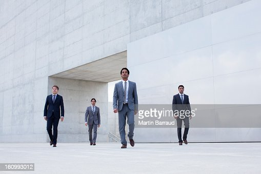 Businessmen leaving modern cultural center