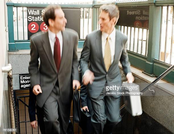 Businessmen leaving subway station