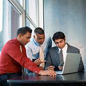 Businessmen looking at laptop computer
