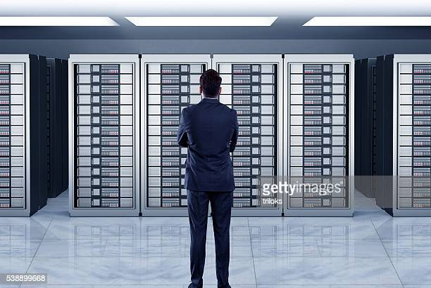 Businessmen looking at server
