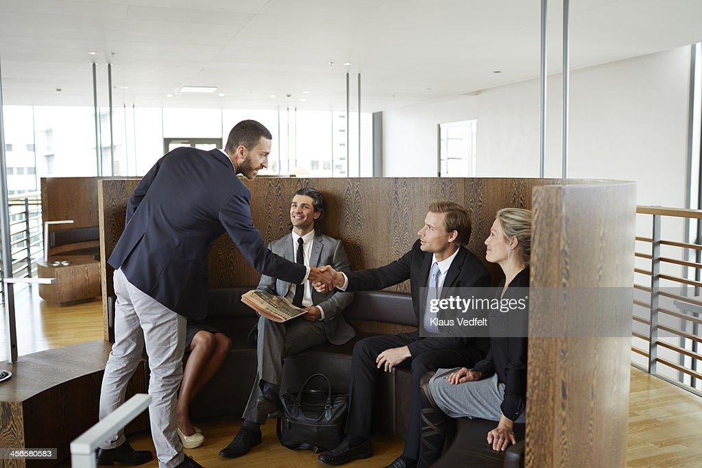 businessmen making handshake in lounge : Stock Photo