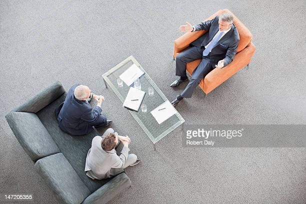 Businessmen meeting in lobby