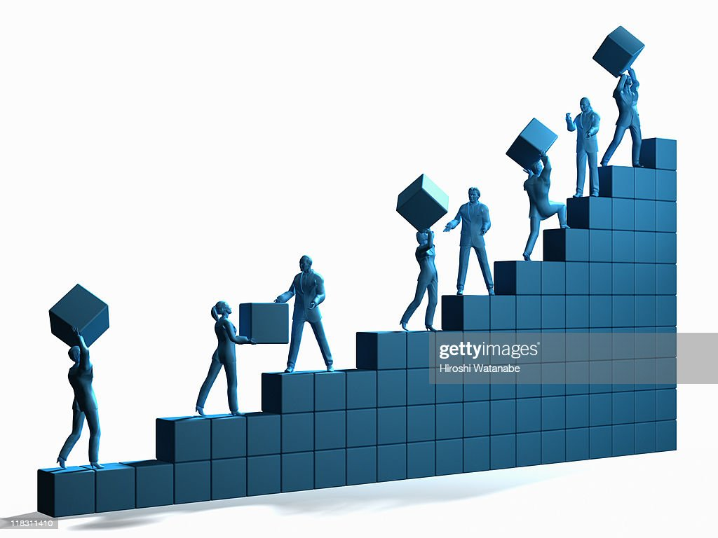 Businessmen moving blocks and going up on graph : Stock Photo
