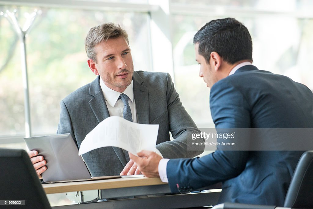 Businessmen negotiating in meeting