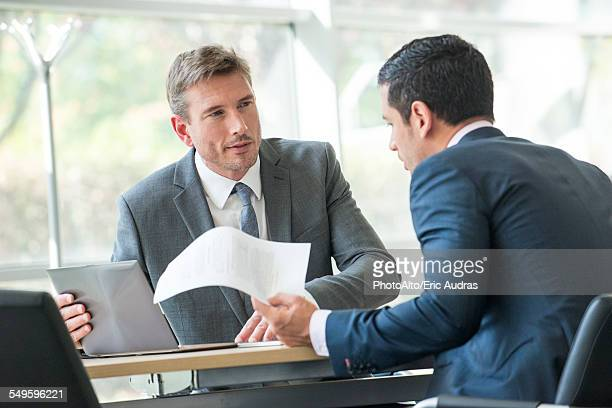 Businessmen negotiating in meeting