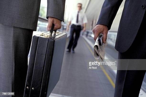 Businessmen on conveyor belt