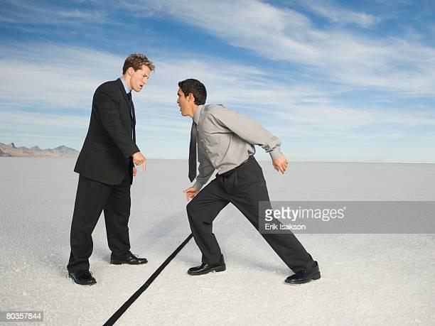 Businessmen on opposite sides of line, Salt Flats, Utah, United States