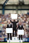 Businessmen on podium in a stadium