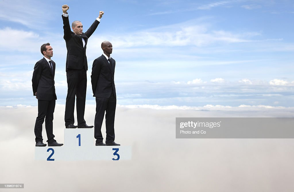 Businessmen on podium in the sky