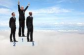 Businessmen on podium in the sky