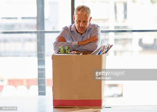 Businessmen packing his belongings away after being fired