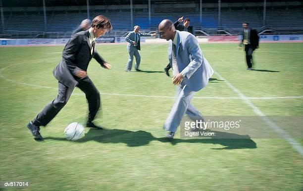 Businessmen Playing Soccer