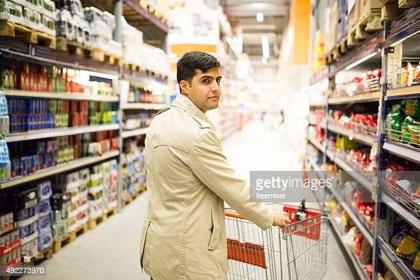 Businessmen pushing shopping cart