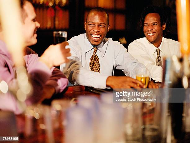 Businessmen relaxing after hours in a bar