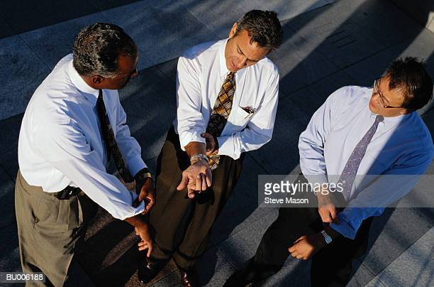 Businessmen Rolling up Their Sleeves