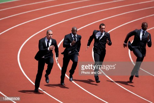 Businessmen runnin g on track : Stock Photo
