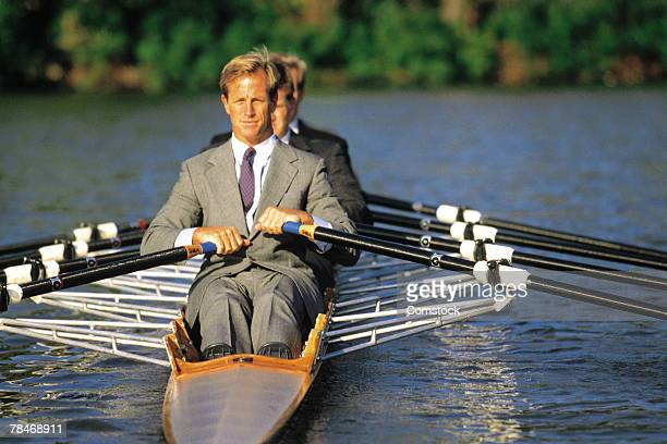 Businessmen sculling