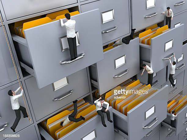 Businessmen searching for needed files
