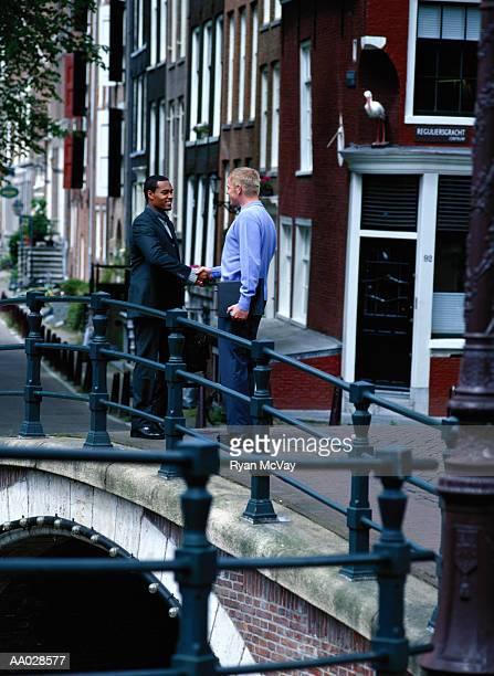 Businessmen Shake Hands on Bridge, Amsterdam