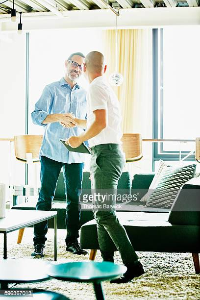 Businessmen shaking hands after meeting in office