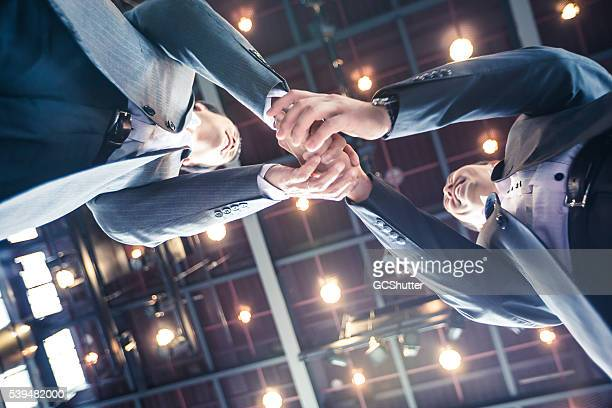 Businessmen shaking hands in agreement over a profitable venture.